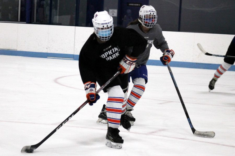 Senior Abby Meyer skates up the ice with the puck during the team's practice on Jan. 7. Hopkins Park prepares for their first game of the season 7 p.m. Jan. 15 at Princeton Ice Arena against Princeton.
