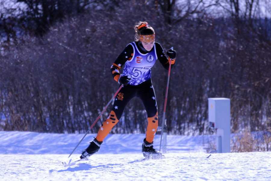 Senior co-captain Olivia Etz climbs a hill Jan. 21. Etz wears the teams official headband that many athletes wear to show team spirit.