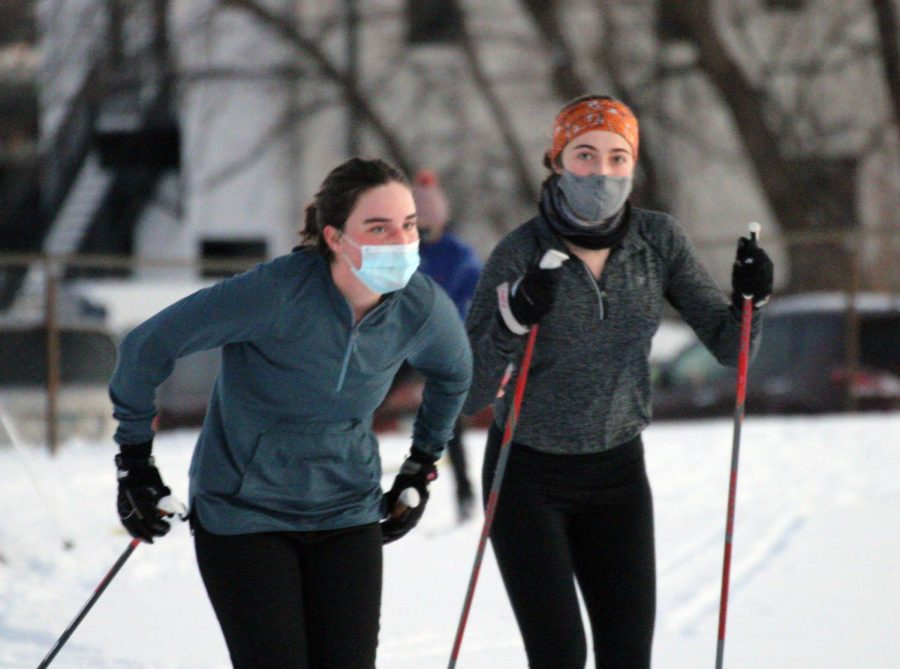 Seniors Claire Bargman and Olivia Etz ski at the track during Nordic's first practice Jan. 4. The Nordic team has been split up into four pods with 25 people each.