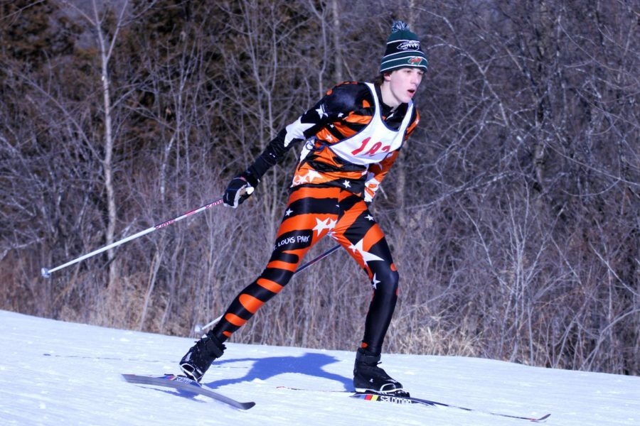 Freshman Martin Gablenko skis during the 5K race at Hyland Park Reserve. Races take place all around the Twin Cities at various cross-country skiing courses.
