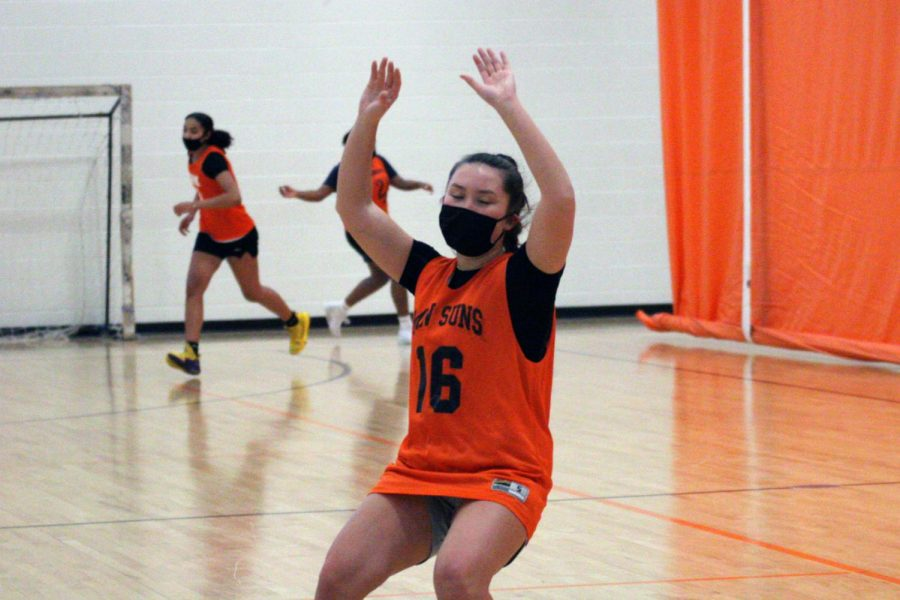 Senior Zoe Bohrod practices blocking the ball during girls' basketball tryouts Jan. 4. Girls' basketball tryouts took place in the field house.
