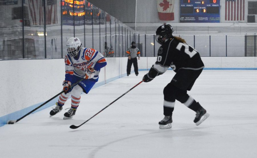 Senior Erin Brousseau maneuvers the puck during the game against Maple Grove Feb. 12. Park's next game is 5:45 p.m. Feb. 16 at Parade Ice Garden.