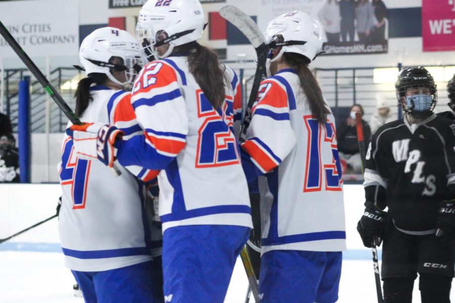 Senior Erin Brousseau celebrates with the team after a goal against Minneapolis. Park led 1-0 after the first period.