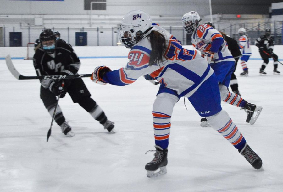 Senior Jarielyz Lopez-Barrera passes the puck to her teammate Feb. 12. Lopez-Barrera plays in a defensive position.
