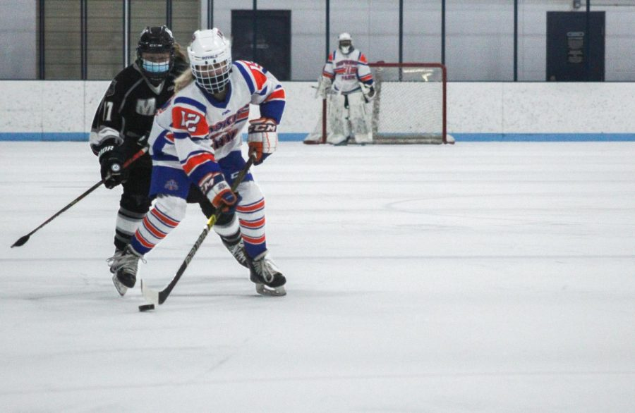Junior Greta Betzer skates with the puck Feb. 12. Park is placed sixth out of seven in its conference.