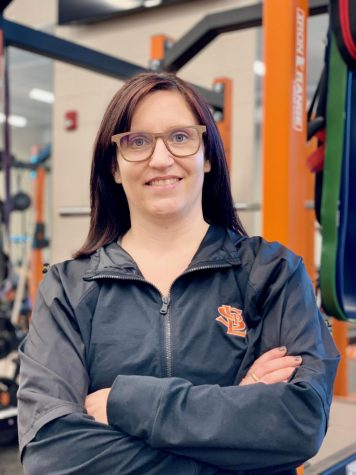 Used with permission from Jessica Gust. Science teacher and strength and conditioning head coach Jessica Gust poses in the weight room Feb. 22. Gust was nominated to serve on the advisory board for the National High School Strength Coaches Association.