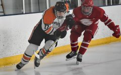 Senior Drew Boyum skates with the puck Feb. 12. Park lost 6-4 to Benilde-St. Margaret's.