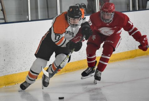 Senior Drew Boyum skates with the puck Feb. 12. Park lost 6-4 to Benilde-St. Margaret's.