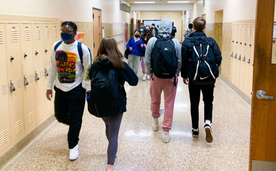 Students walk through the A3 hallway as they head to their next class Feb. 22. The return of hybrid learning has brought mixed emotions among students.