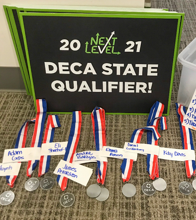 Street signs and medals are set out by the main office for Park's DECA State qualifiers Feb. 12. These medals were given to the students who moved on from the District competition.