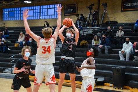 Junior Henry Odens goes for a contested shot in the game Feb. 5. Park lost to Benilde 65-47.