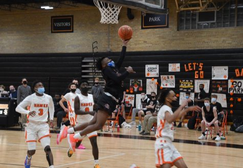 Senior Derric Standifer goes for a heavily contested layup in the game Feb. 16. Park lost to Cooper 64-56.