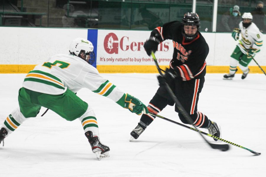 Senior Jack Wandmacher shoots and scores a goal against Edina Jan 14. Wandmacher will be playing next year for the Ice Rays in Corpus Christi, Texas.
