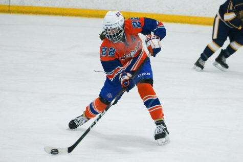 Senior Erin Brousseau passes the puck to a teammate in a Jan. 30 game. The girls