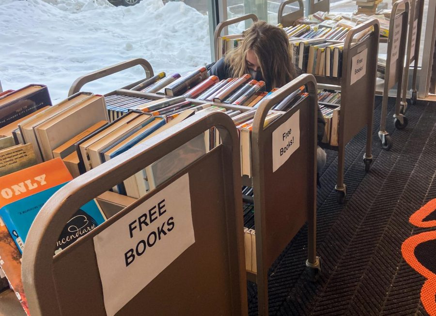 Senior Megan Raatz looks through the books in the used book drive to read during distance learning Feb. 3. These books were donated by the Park library and are free for students to use.