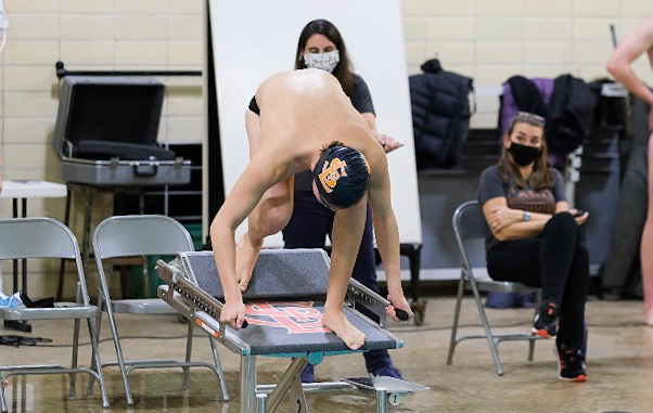 Junior Andre Barajas stands on his block waiting for his race to begin Feb. 18. Barajas and four others qualified for the Minnesota State swim meet.
