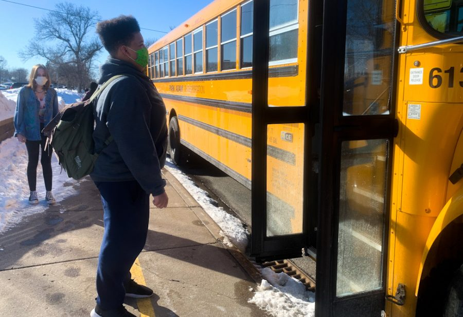 Students board buses after school March 1. Late buses March 1 caused many students to be late to school.