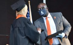 Superintendent Astein Osei congratulates students during graduation June 6. Osei will be conducting a search to find Park's new principal.
