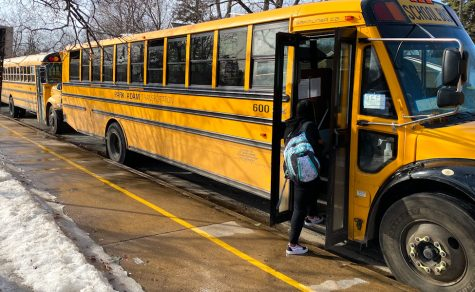 Students getting on buses after school March 8. COVID-19 has created a different atmosphere where bus drivers and students must focus on adapting to the situation.