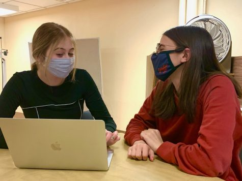 Sophomores Fiona Shaack and Fiona Long working together March 19. Along with their group, they advocated for feminine hygiene dispensers to be put in at Park.