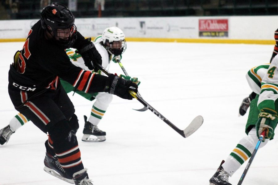 Senior captain McCabe Dvorak attempts to shoot the puck at Edina's goalie. Park's overall record for the 2020-21 season was 9-5-1.