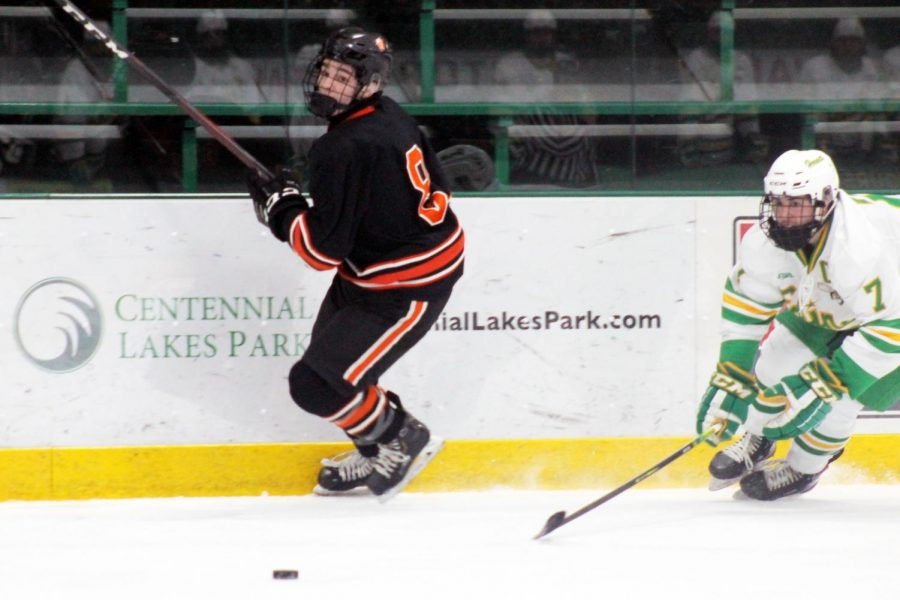 Sophomore Teddy Dahlin chases after the puck. Dahlin scored four goals during the 2020-21 season.