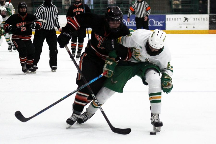 Senior Jack Wandmacher tries to obtain the puck from Edina. Park finished second in its conference standings.