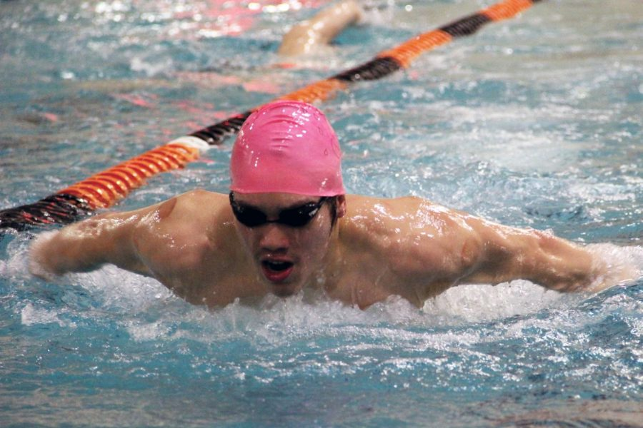 Senior captain Hayden Zheng practices his butterfly stroke March 10. Boys' swimming placed third at its Sections meet March 13.
