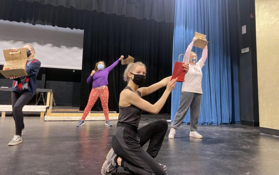 "Junior Renee McSherry poses during rehearsal for the spring musical March 12. The cast was practicing the dance for the song ""Delivery."""