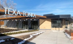 Shops and restaurants in the Texa-Tonka neighborhood March 18. Brito's Burrito opened March 31, and Angel Food Bakery is expected to open late June.