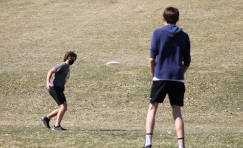Freshmen Tommy Walsh and Thomas Shope throw a frisbee around at Minikahda Vista park April 3. Spring sports are in full session as of April 5.