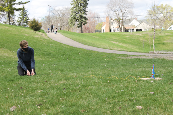 Junior Joe McGurgan launches his rocket at Minikahda Vista park April 18. McGurgan and his friends were influenced by others in the park to start building their own rockets.