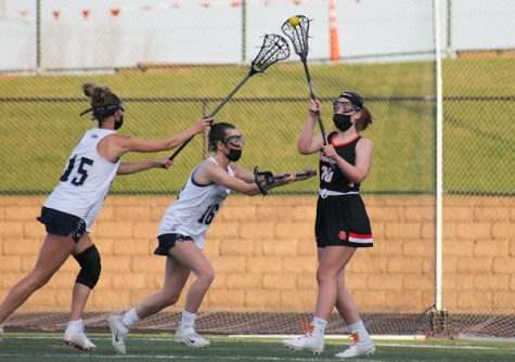 Freshman Meg Ridgeway passes the ball to a teammate April 29. Park lost to Chanhassen 17-0.