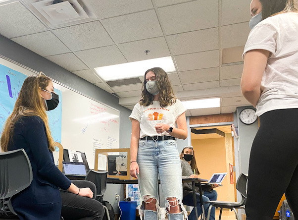 Editor-in-Chief and Minnesota Journalist of the Year Talia Lissauer works with peers in the classroom April 16. Lissauer spent three to four months working on a portfolio to win the award.