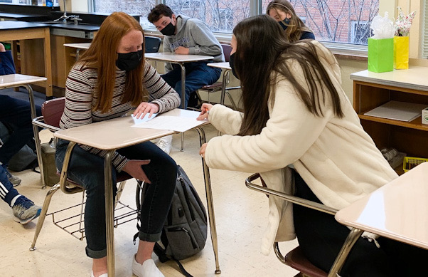 Juniors Marley Miller and Ava Hanson collaborate in their IB Biology class. Director of Curriculum and Instruction at St. Louis Park Public Schools Patrick Duffy said all students will be required to take an advanced course during their time in high school.