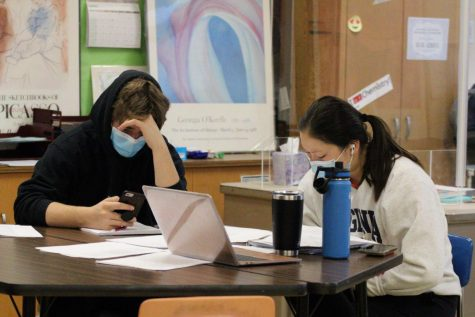 Seniors Emma Amon and Jack Fredrickson work during english class April 19. Many students were involved in the interview process for the new principal.