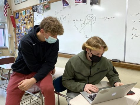 Juniors Henry Odens and Thomas Moot work together in their second hour precalculus class April 12. Park transitioned to in-person learning April 12.