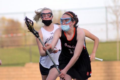 Senior Claire Bargman catches the ball April 30. Girls