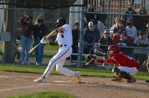 Junior Brady Walsh hits the ball in the game April 22. Park lost to Benilde 9-5.