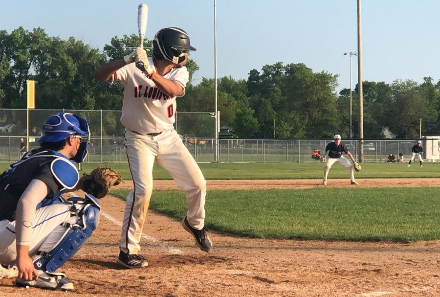 Junior Stanley Regguinti swings at the ball during the game on Friday. Park lost with a final score of 1-3.
