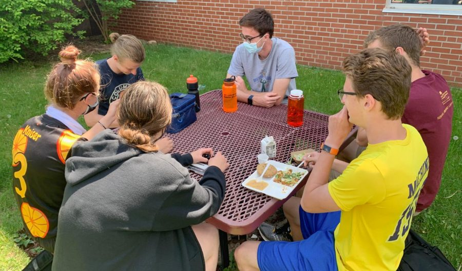 Seniors eat lunch outside May 25. Caps and gowns for graduation will be distributed June 2.