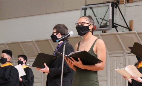 Senior Ari Braveman sings behind Junior Jada Macklemore. Park Singers held a concert May 21.