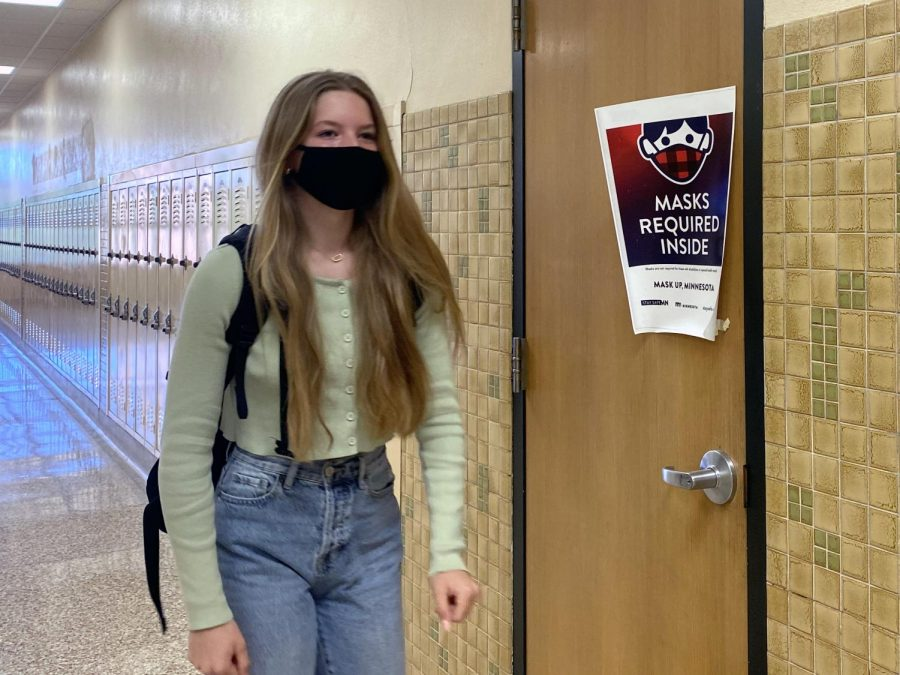 Sophomore Kamryn Halley walks to class May. 7. The mask mandate in Minnesota is planned to be lifted July 1.