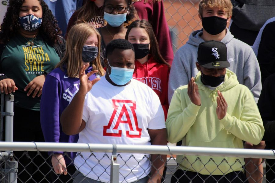 Senior Michael Boxley shows school spirit for University of Arizona May 3. Students were told to wear spirit gear of the college they are planning on going to.