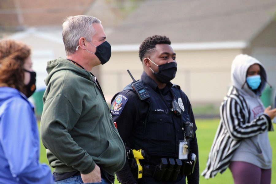 Grade Level Coordinator Greg Whittle and School Resource Officer Maurice Smith oversee the senior celebration May 3. Seniors gathered on the track to celebrate college decision day.