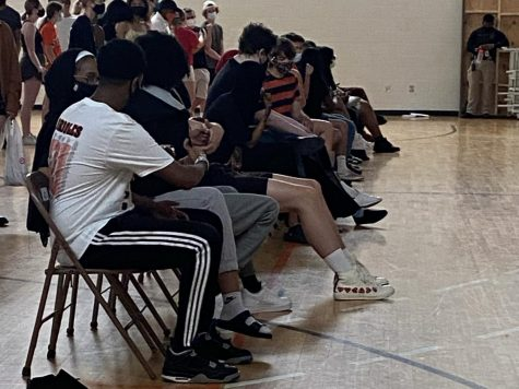 Seniors sit in their rows for graduation rehearsal. Rehearsal was held at 12 p.m. June 8 at the field house.