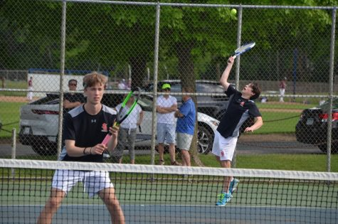 Junior Robert Perelman serves a ball to score in his match May 21. Park lost to Blake in their last game of the season 7-0.