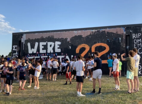 Students painting the wall and each other June 9. Juniors traditionally paint the wall every year after graduation.