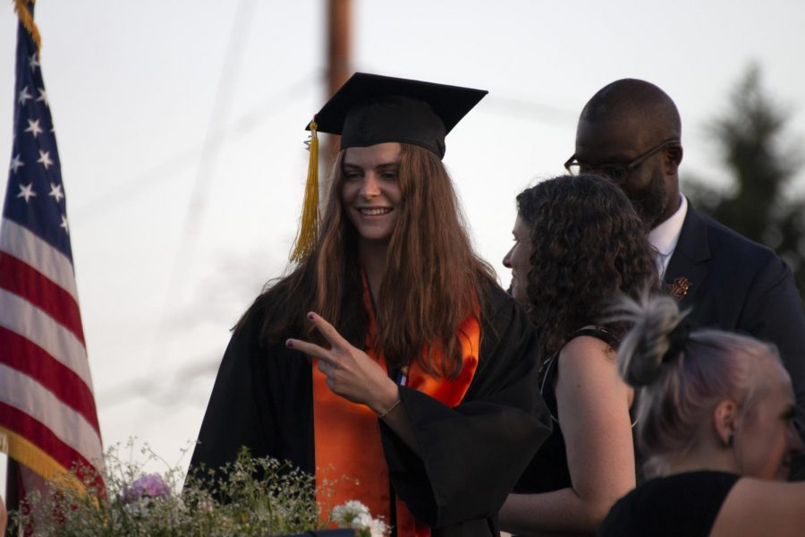 Senior Erin Brousseau celebrates receiving her diploma June 8. Seniors were encouraged to celebrate with creative faces as they walked down the stage during the commencement.