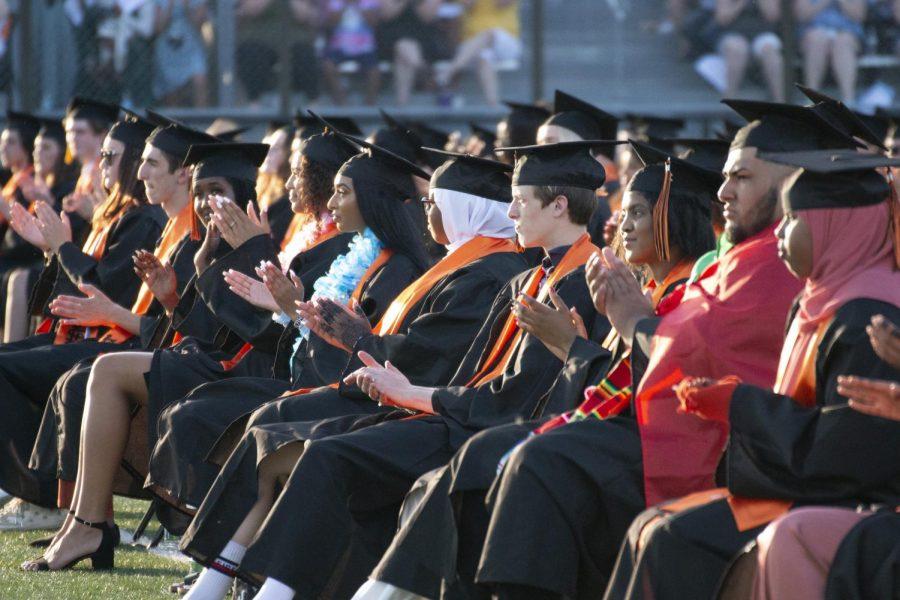 Park seniors clap for fellow graduates as the commencement ceremony continues June 8. Attendees to the commencement ceremony were not required to wear masks.